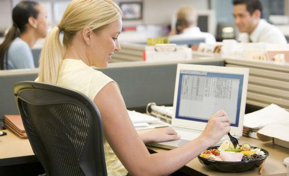 women eat food at office